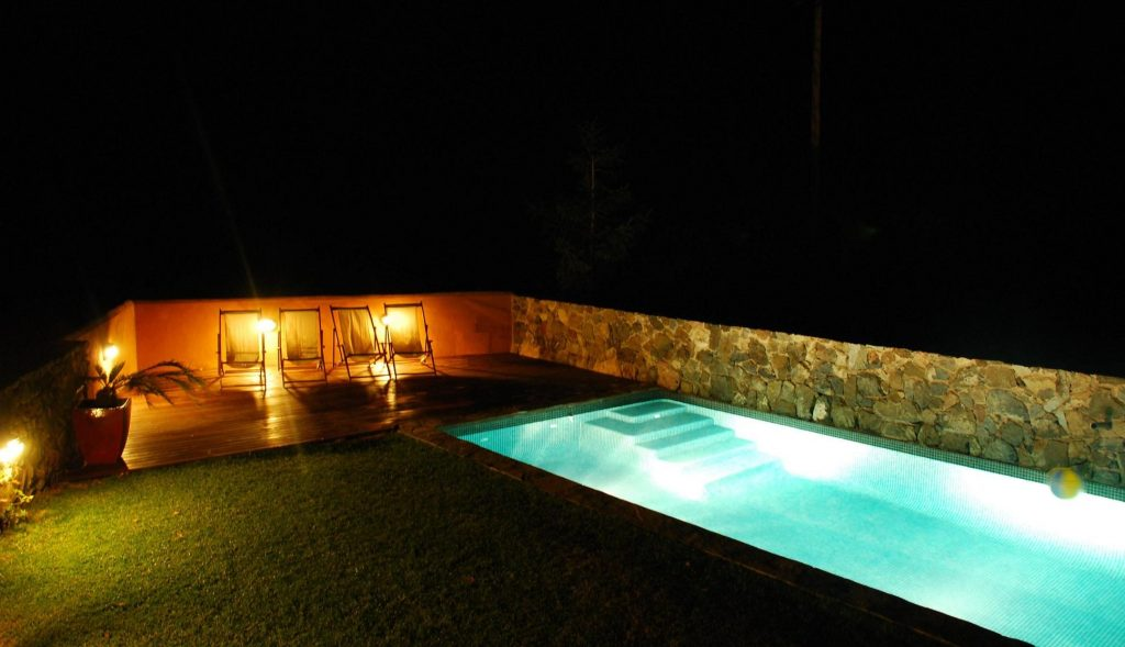 Lighted pool at night, summer evenings in Casa Argentera