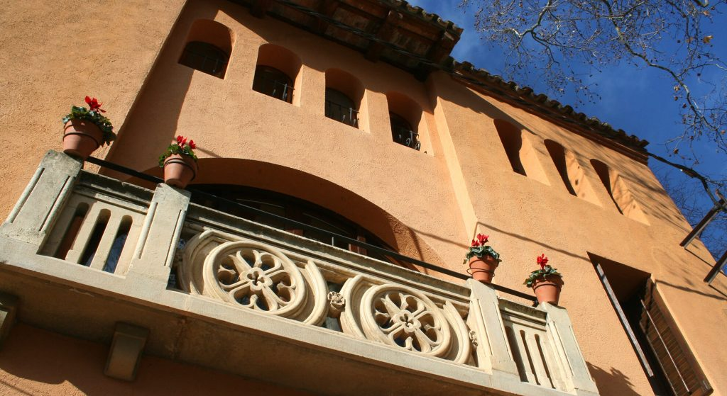 Balcony stone carved facade of Casa Argentera